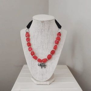 Handmade red necklace with silver pendant